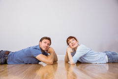 Couple lying on the floor Royalty Free Stock Photo