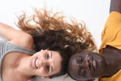 A couple lying on the floor with white Royalty Free Stock Images