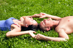 Couple Lying on the Gras Stock Photo