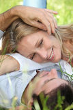 Couple lying in the grass Royalty Free Stock Image