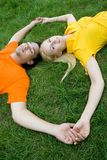Couple lying on grass. Couple Lying on the Grass, Smiling Royalty Free Stock Image