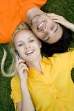 Couple lying on grass Royalty Free Stock Image