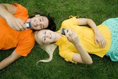 Couple lying on grass Royalty Free Stock Photography