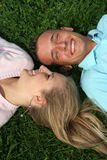 Couple Lying on the Grass Stock Photos