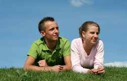 Couple Lying on the Grass Royalty Free Stock Image