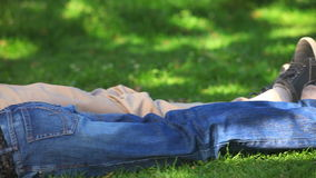 Couple lying on the grass stock video