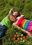Couple lying on grass and enjoys Royalty Free Stock Image