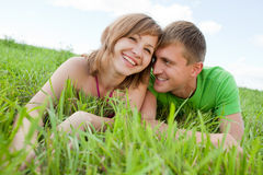 Couple lying on grass and enjoys Royalty Free Stock Images