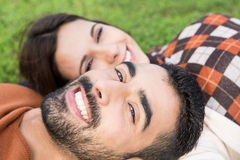 Couple lying in grass Royalty Free Stock Photos