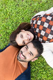 Couple lying in grass Stock Photos