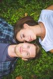 Couple lying on grass Stock Photos