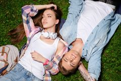 Couple lying on a grass in a park Stock Photos