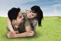 Couple Lying On Grass Stock Photography