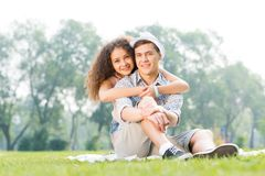 Couple lying on the grass in the summer park Royalty Free Stock Image