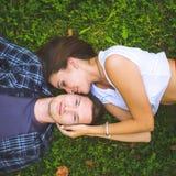 Couple lying on grass Stock Photo