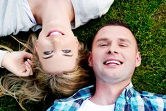 Couple lying on the grass Stock Photos