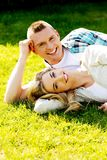 Couple lying on the grass Stock Images