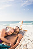 Couple lying in hammock Stock Photography