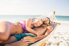 Couple lying in hammock Stock Images