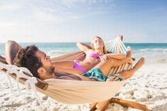 Couple lying in hammock Stock Photos
