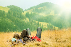 Couple lying in on the hills. With beautiful mountains in the foreground Royalty Free Stock Photos