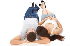 Young couple together lying with arms behind head Stock Photo