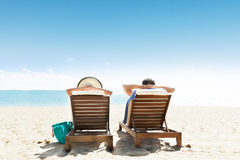 Couple Lying On Lounge Chair Stock Image