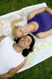 Couple lying on map Stock Photography