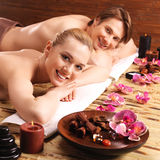 Couple lying on the massage desks. Royalty Free Stock Photography