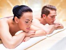 Couple lying on the massage desks. Stock Images