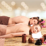 Couple lying on the massage desks. Royalty Free Stock Image
