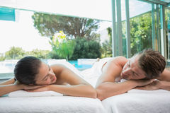 Couple lying on massage table at spa center Royalty Free Stock Images