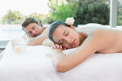 Couple lying on massage table at spa center Stock Images