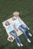 Couple lying on picnic blanket. Royalty Free Stock Photography