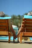 Couple lying by pool Stock Photo