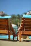 Couple lying by pool Stock Photo