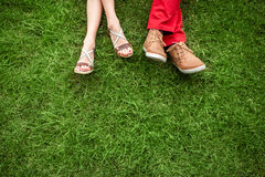 Couple lying and relaxing on the grass Stock Images