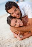 Couple lying on sand Royalty Free Stock Photography