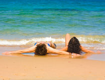 Couple lying by a sea. Loving couple lying down by a sea Royalty Free Stock Images