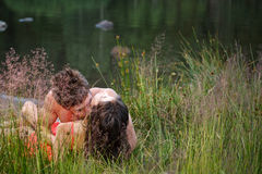 Couple lying on shore Royalty Free Stock Photography