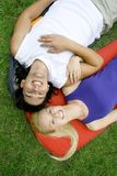 Couple lying on sleeping bags Royalty Free Stock Photo