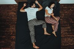 Couple is Lying and Sleeping on Bed royalty free stock photo