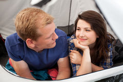 Couple lying in a tent Stock Photos