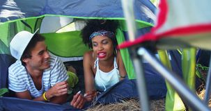 Couple lying on tent at music at music festival 4k. Happy couple lying on tent at music at music festival 4k stock video