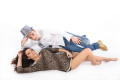 Couple lying on th efloor looking up Stock Photos