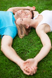 Couple lying together head to head Royalty Free Stock Image