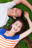 Couple lying together head to head Stock Image