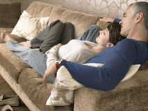 Couple Lying Together On Sofa Royalty Free Stock Photography