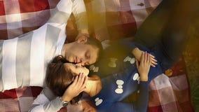 Couple Lying Under autumn Tree. Romantic Couple lying under autumn tree stock video footage