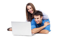Couple lying and using laptop Royalty Free Stock Images